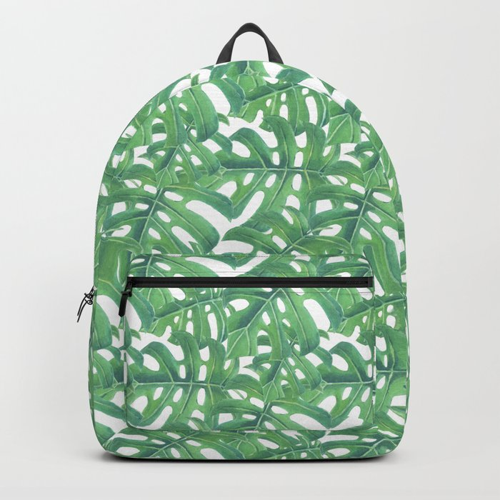 Green monstera tropical leaves pattern  on white background Backpack