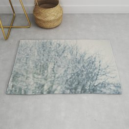 an abstract photograph of a tree & falling sn Rug