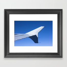 Airplane wing on a blue sky  Framed Art Print
