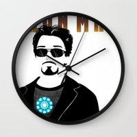 tony stark Wall Clocks featuring Tony Stark is IRON MAN by Elisehill3