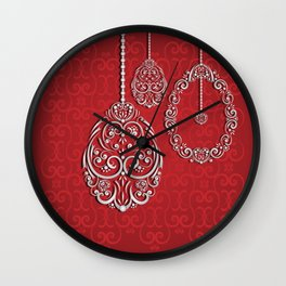 Silver lace hanging eggs on vibrant red background Wall Clock