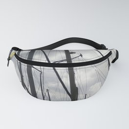Yacht masts on cloudy sky Fanny Pack
