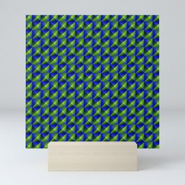 Tiled pattern of dark blue rhombuses and green triangles in a zigzag and pyramid. Mini Art Print
