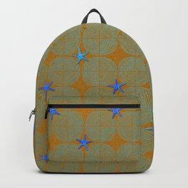 Blue starfish on a green beach Backpack