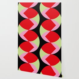 Snake Shaped Window in a black wall. Red and pink acorns in the background, on a soft green grass. Wallpaper