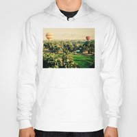 hot air balloons Hoodies featuring Hot Air Balloons Before Mountains  by Limitless Design