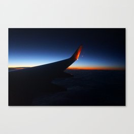 Flying over the west coast at sunset Canvas Print
