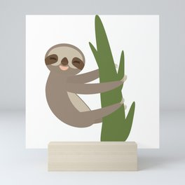 Three-toed sloth on green branch on white background Mini Art Print