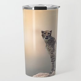 Young Cheetah sitting on a rock Travel Mug