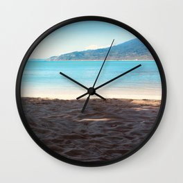 Sometime at the beach Wall Clock