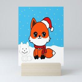A Fox in the Snow Mini Art Print