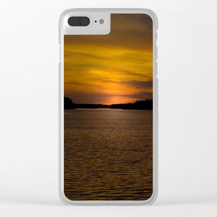 The sun goes down and night falls Clear iPhone Case