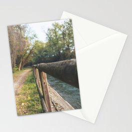 Irrigation ditch in the Ticino river natural park during winter before sunset Stationery Cards