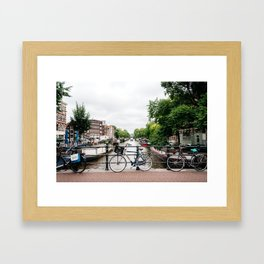 Bicycles in Amsterdam canal Framed Art Print