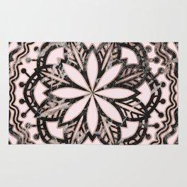 Marble mandala - striking black and rose gold Rug