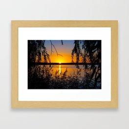 sundown at a lake Framed Art Print