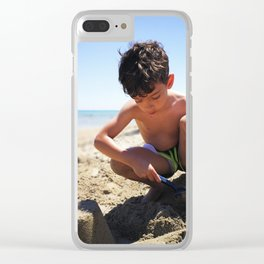 Young boy playing on the beach in Salento Clear iPhone Case