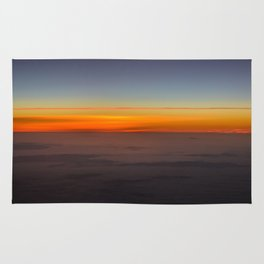 Sunrise over clouds Rug