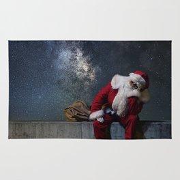 Santa Claus with sack. Magic Christmas Lights. Rug