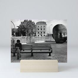 Girl and Baby head in Atocha Station, Madrid Mini Art Print