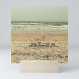 sandcastle on the shore Mini Art Print