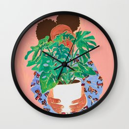 Adventure Stories for Introverts: Lethabo and the Delicious Monster, Woman with Indoor Plant Painting on Pink Wall Clock
