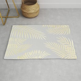 Gold palm leaves on grey Rug
