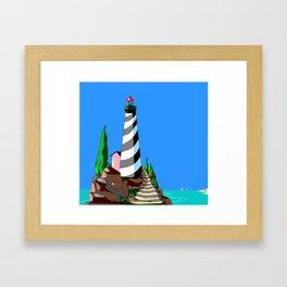 A Lighthouse over looks the Rocky Cove and Beach Framed Art Print