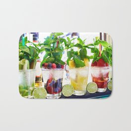 Fruit and berry cocktails with mint in cafe Bath Mat