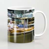 baking Mugs featuring Baking the alligator bread by Stu Naranch