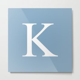 Letter K sign on placid blue background Metal Print