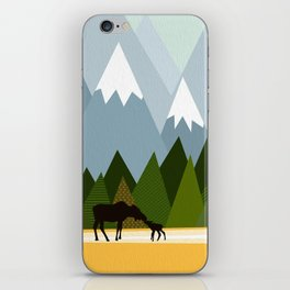 Woodland snowy mountain tops trees and mother moose and baby iPhone Skin