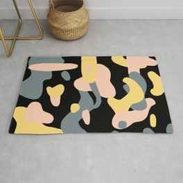 Grey, Pink, and Yellow Splotches on Black Rug