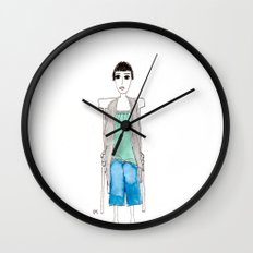 girl in another chair Wall Clock