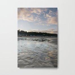 Sunset sky and beach huts reflected in a water at low tide. Wells-next-the-sea, Norfolk, UK. Metal Print