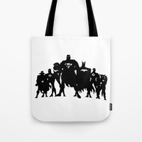 justice league Tote Bags featuring Justice League Silhouette by iankingart