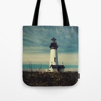lighthouse Tote Bags featuring Lighthouse by Yellowstone Photo Studio