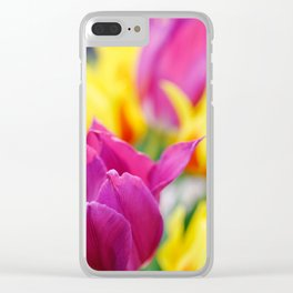 Group of fresh pink, yellow and red tulips in a garden. Nice floral abstract background. Clear iPhone Case