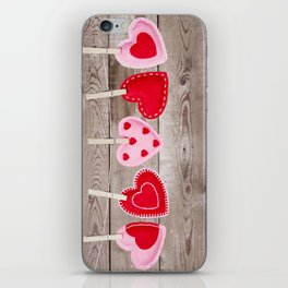 II - Clothesline with Valentine's Day hearts decorations on a rustic background iPhone Skin