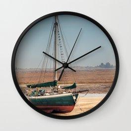 Sail boat stranded at low tide Wall Clock
