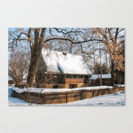 Old Romanian Cottage covered in snow Canvas Print