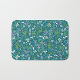 Edelweiss flowers with hellebore and snowdrops on blue background Bath Mat