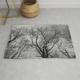 Black and white haunting forest Rug