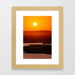 Lost in the warm sunset Framed Art Print
