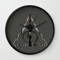 deathly hallows Wall Clocks featuring Master of Death by Talesanura