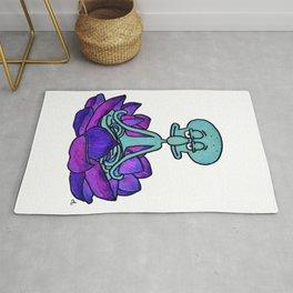 Squidward meditating in lotus flower Rug