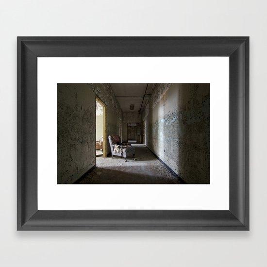 Chair in asylum hallway Framed Art Print