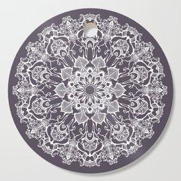 hand drawn white mandala on dark violet background Cutting Board