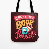 risa rodil Tote Bags featuring Certified Book Addict by Risa Rodil