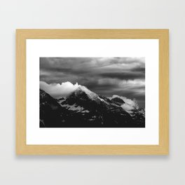 White clouds over the dark mountains Framed Art Print